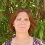 Sandra McDonald portrait with plant background